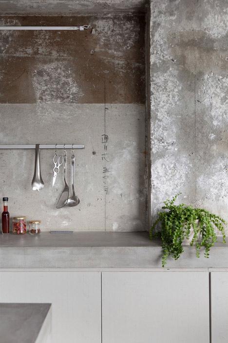 Bare-concrete-apartment-by-Airhouse-Design-Office-presents-its-own-fashion-exhibitions_dezeen_3